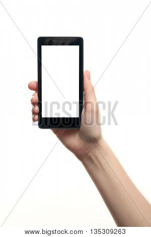 Female hand holding a smartphone on white background