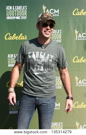 ARLINGTON, TX - APR 18: Lucas Hoge attends the ACM & Cabela'??s Great Outdoor Archery Event during the 50th Academy Of Country Music Awards at the Texas Rangers Youth Ballpark on April 18, 2015.