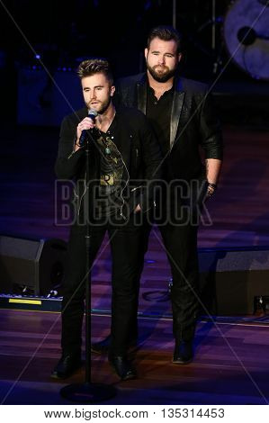 NASHVILLE, TN-SEP 1: Colton Swon (L) and Zach Swon of the Swon Brothers onstage during the 9th Annual ACM Honors at the Ryman Auditorium on September 1, 2015 in Nashville, Tennessee.