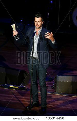 NASHVILLE, TN-SEP 1: Luke Bryan accepts the Gene Weed Special Achievement Award during the 9th Annual ACM Honors at the Ryman Auditorium on September 1, 2015 in Nashville, Tennessee.