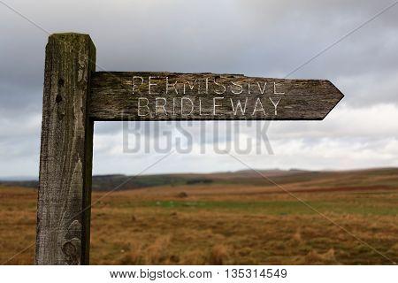 Old Weatherbeaten Wooden Permissive Bridleway Sign on Dartmoor, Devon, UK