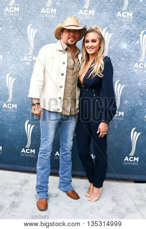 NASHVILLE, TN-SEP 1: Jason Aldean (L) and wife Brittany Kerr attend the 9th Annual ACM Honors at the Ryman Auditorium on September 1, 2015 in Nashville, Tennessee.