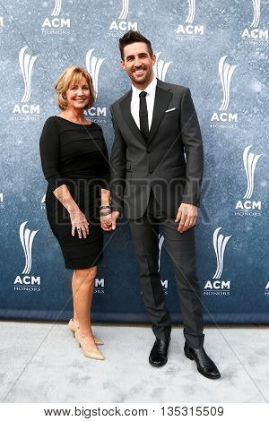 NASHVILLE, TN-SEP 1: Jake Owen (R) and mother Mitzi Owen attend the 9th Annual ACM Honors at the Ryman Auditorium on September 1, 2015 in Nashville, Tennessee.