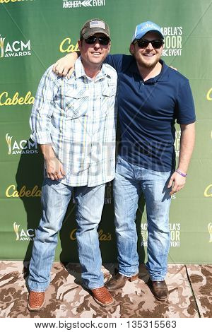 ARLINGTON, TX - APR 18: Recording artists Casey Donahew (L) and Josh Abbott attend the ACM & Cabela'??s Great Outdoor Archery Event at the Texas Rangers Youth Ballpark on April 18, 2015.