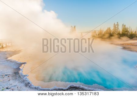 Steaming blue hot spring in Yellowstone National Park