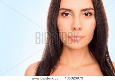 Close Up Portrait Of Beautiful Calm Brunette  Showing Her Fase With Perfect Skin With Arrows