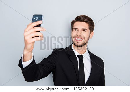 Handsome Smiling Man In Black Suit Making Selfie