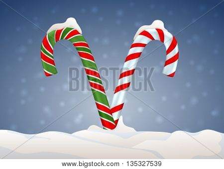 Christmas candy cane with snow on blurred background. Christmas candies background. Candy cane background with snow flakes over blue. Merry Christmas.