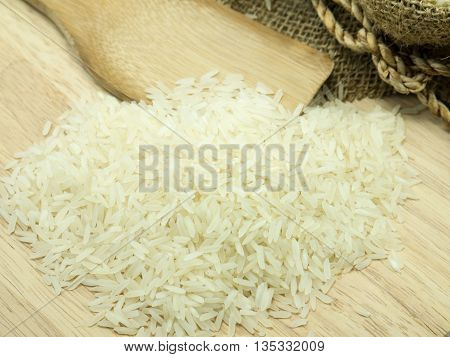 rice on a chopping broad background .