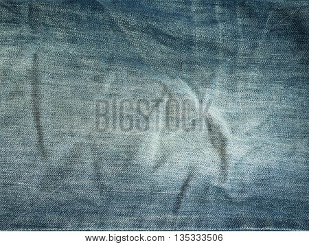Texture of blue jeans for background .