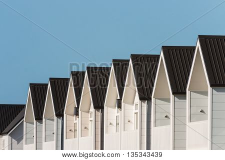 new terraced houses with blue sky and copy space