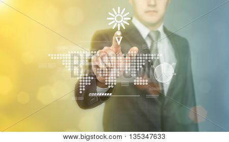 Businessman touching the digital touch screen by his finger. Weather forecast. Sunny and no rain. Innovative technology. New future. Cropped photo. Business staff. Business concept.