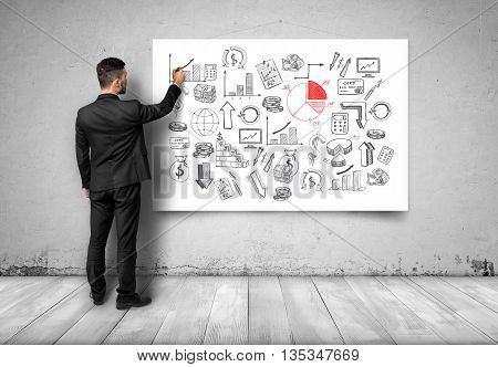 Back view of businessman drawing economic graphics on white canvas. Business plan. Deep research. Economic and statistical graphs. Financial and business concept. Srategic calculation and research.