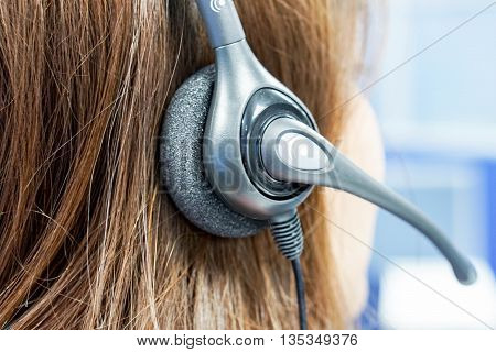 close up a callcenter on the job with headset