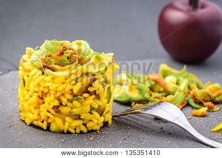 plate of healthy zucchini rice with flowers and saffron