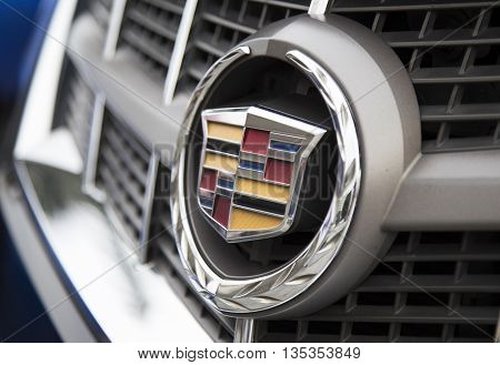 Shenzhen, China - Jun 14, 2016: Close up of the logo of Cadillac on the car front, taken within a test drive. is a division of U.S.-based General Motors (GM) that markets luxury vehicles worldwide.