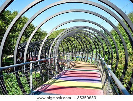 Slinky Springs Bridge. Modern bridge with multicolored gangway.