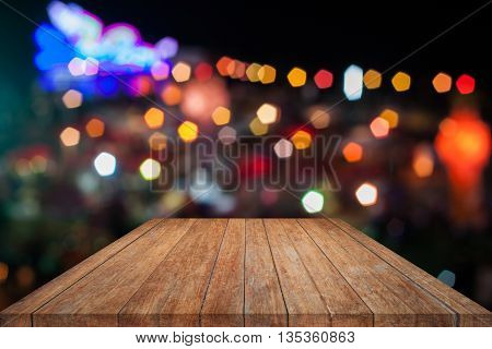 Brown wooden with abstract blurred bokeh lights, stock photo