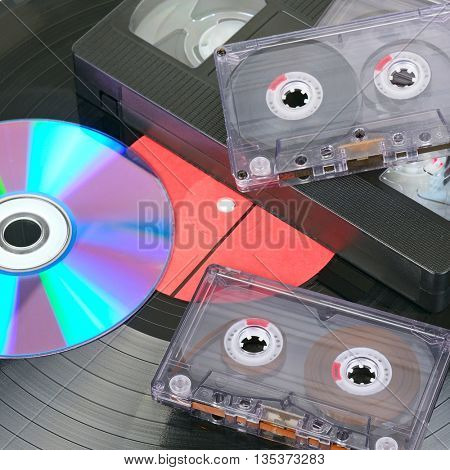 Vinyl disc, audio and video cassettes. Background
