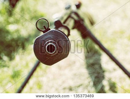 Close up photo of heavy sniper rifle from World War II. Gun scene. Gun barrel. Armed conflict. Military theme. Portable weapon. Retro photo filter. Shooting position.