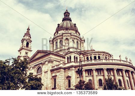 Saint Stephen's basilica is a roman catholic basilica in Budapest Hungary. Architectural theme. Cultural heritage. Retro photo filter. Religious architecture. Travel destination. Famous place.