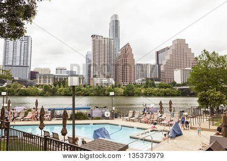 AUSTIN USA - APR 10: Hotel pool and view of the Austin downtown skyline at the Colorado River. April 10 2016 in Austin Texas United States