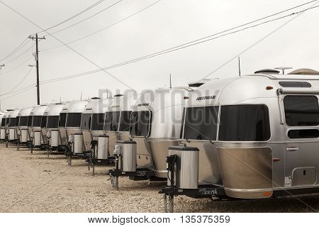 AUSTIN USA - APR 11: Row of new luxury american Airstream trailers at a dealership in Texas. April 11 2016 in Austin Texas United States
