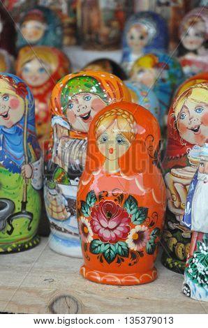Russian dolls babushka (or matreshka) or Colorful Russian nesting dolls at the market.