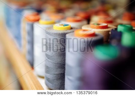 Colorful thread spools used in fabric and textile industry