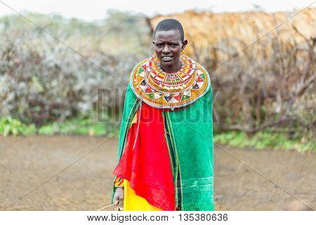 Massai woman standing in her village