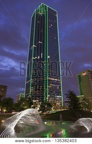 DALLAS USA - APR 9: The Bank of America Plaza skyscraper building in Dallas downtown illuminated at night. April 9 2016 in Dallas Texas United States