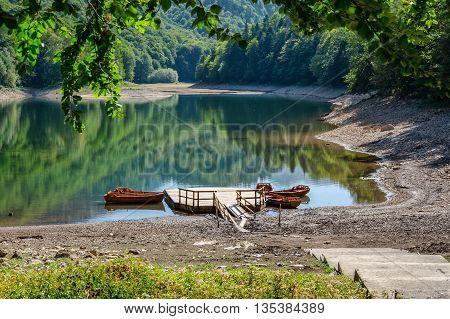Kolasin Montenegro - September 29 2012: Biograd Lake within mountains with pier and boats in Biogradska Gora national park