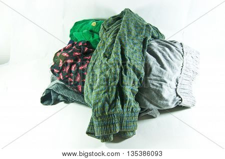 pile of old underwear on white background