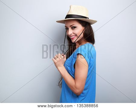 Happy Joying Woman With Sraw Hat Looking With Natural Emotion On Blue Background