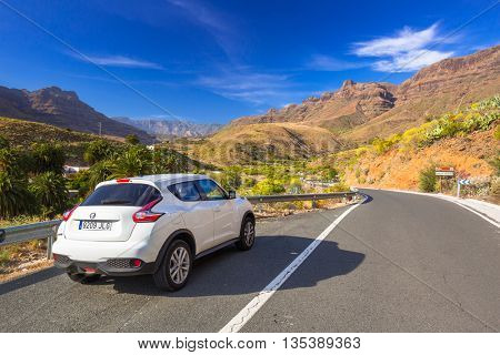 GRAN CANARIA, SPAIN - APRIL 21, 2016: White Nissan Juke in the mountain scenery of Canaries. The Nissan Juke is a mini sport utility vehicle (SUV) produced by the Japanese manufacturer Nissan.