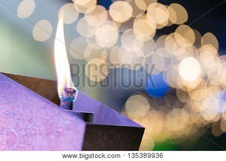 Flaming torch or candle in garden beautiful bokeh background macro close-up shot