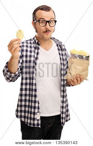 Vertical shot of a joyful young man eating potato chips isolated on white background
