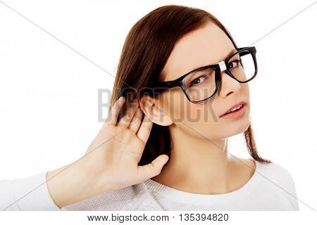 Shocked young woman overhearing a conversation