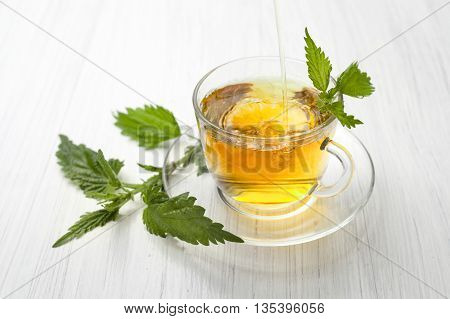 herbal tea with nettle on white baground