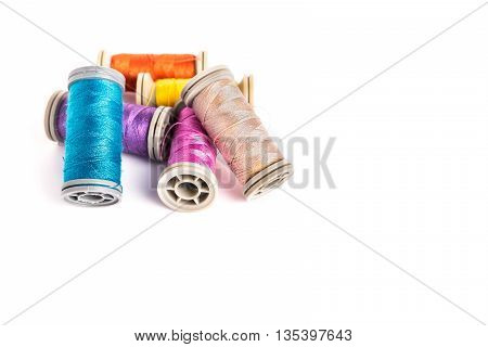 Multi-colored threads sewing kit a set of tailor on white background