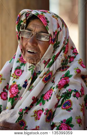 ABYANEH - APRIL 20: Portrait of unknown old woman in a street of Abyaneh, Iran on April 20, 2015. Abyaneh is small mountain village, at the 2006 census, its population was 305, with 160 families.