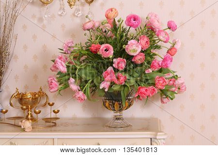 bouquet of beautiful pink flowers in a vase on a white table