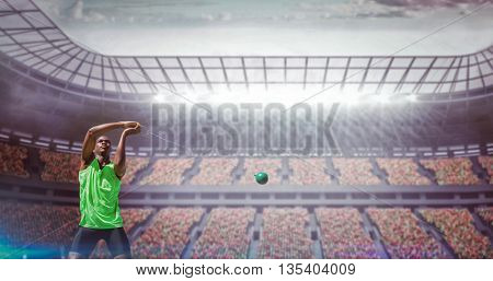 Front view of sportsman practicing hammer throw against race track
