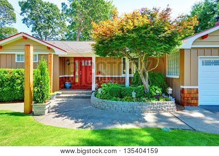 Cute Small Rambler House With Red Door And White Trim.