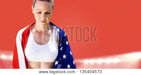 Portrait of american sportswoman unsmiling against red background