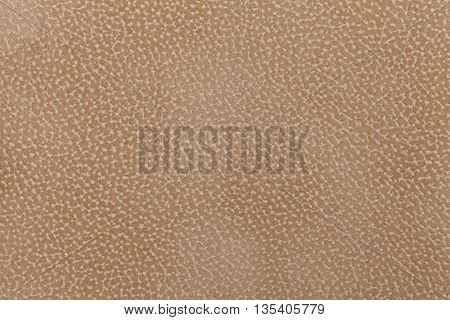 Background of light brown fabric flock decorated with a coat of the animal. Lint-free cloth suede.