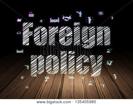 Political concept: Glowing text Foreign Policy,  Hand Drawn Politics Icons in grunge dark room with Wooden Floor, black background