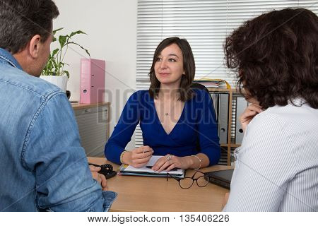 Female Business Broker Or Investment Adviser As They Attend Meeting