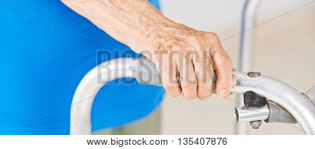 Hands of senior woman using a walker for support