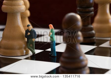 Little People On a Chess Board Talking